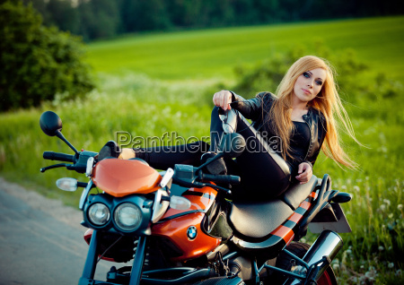 young sexy woman sitting on red