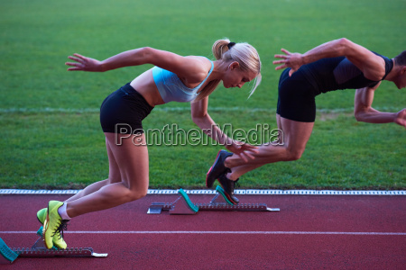 woman group running on athletics