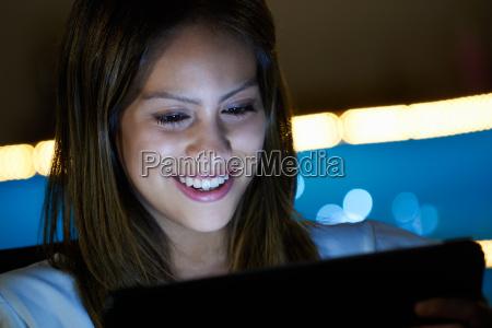 latina teenager using social media on