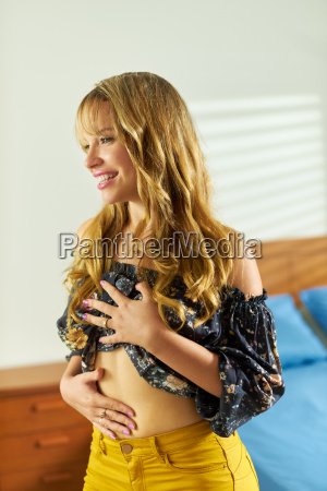 beautiful woman dieting contemplating belly weight