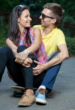 young couple in love sitting on