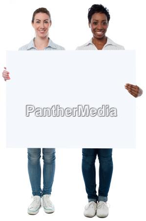 women displaying blank whiteboard