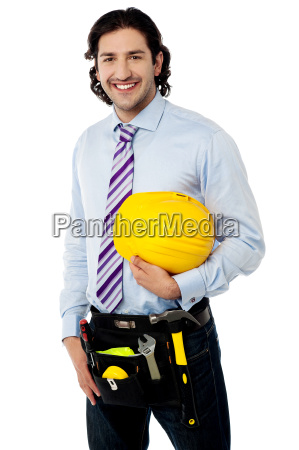 construction worker wearing tool belt