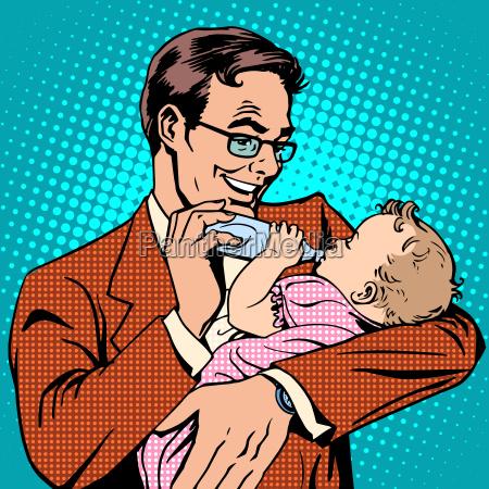 happy father feeding newborn baby with