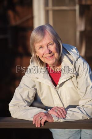 senior woman leaning on railing