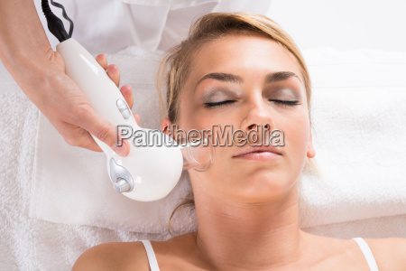 woman receiving cellulite vacuum therapy on