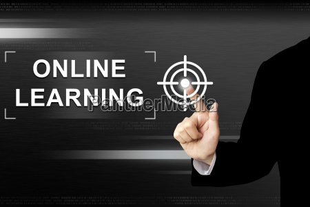 business hand pushing online learning button
