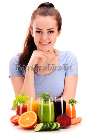 young woman with variety of vegetable