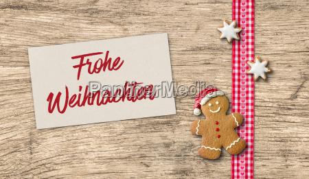 lebkuchenmann mit weihnachtskarte