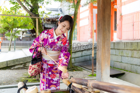 japanese woman using the water bamboo