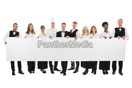 confident restaurant staff holding blank billboard