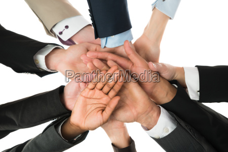 business team stacking hands