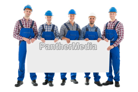 confident male construction worker holding blank
