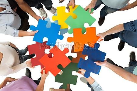 creative business menschen mit bunten puzzle