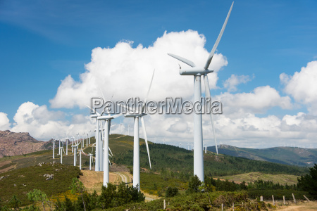 onshore wind power plant on hilltop