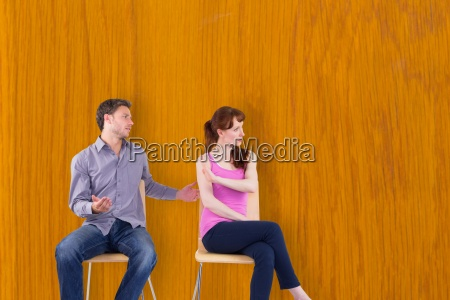 composite image of sitting couple having