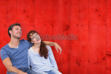 composite image of couple sitting on