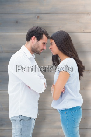 composite image of angry couple facing