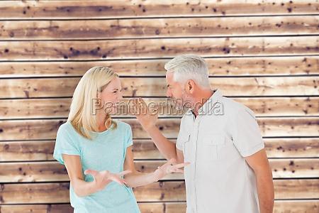 composite image of unhappy couple having
