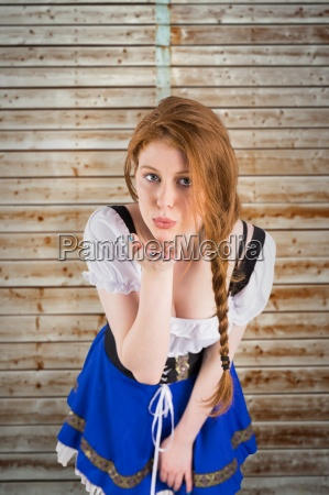 composite image of oktoberfest girl blowing