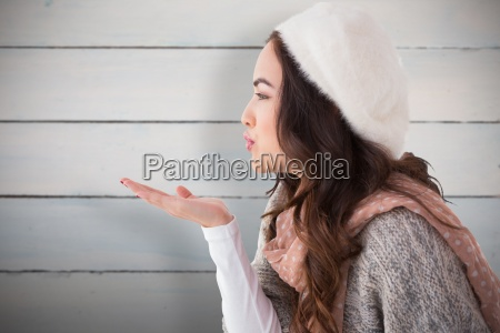 composite image of brunette in winter