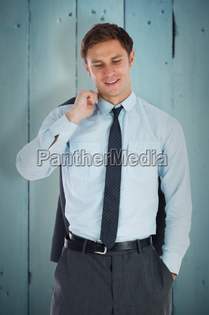 composite image of smiling businessman holding