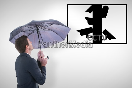 composite image of businessman holding an