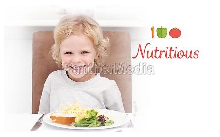 nutritious against cute little boy eating