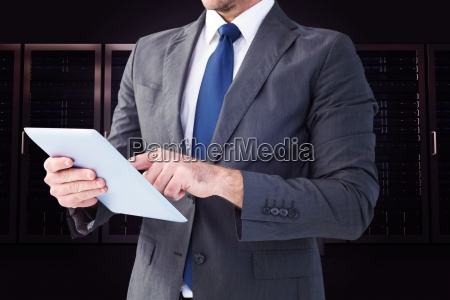 composite image of businessman using his