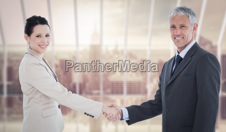composite image of smiling business people