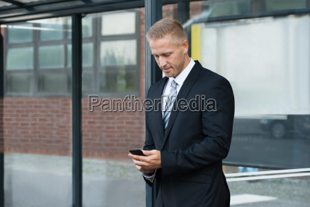 businessman looking at cellphone