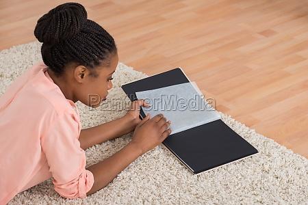 woman looking blank photo album