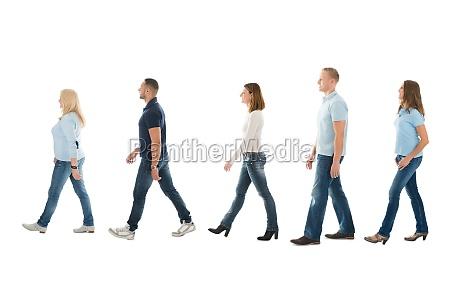 side view of people walking in