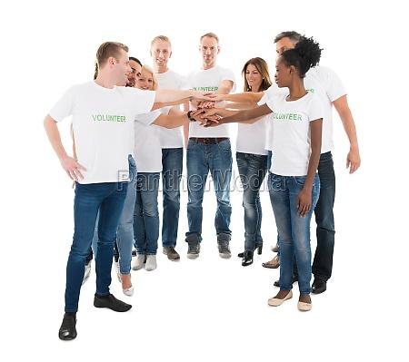 group of multiethnic volunteers stacking hands