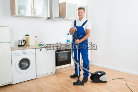 portrait of janitor cleaning floor with
