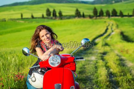 young woman traveling by a scooter