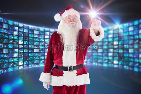 zusammengesetztes bild von weihnachtsmann zeigt auf