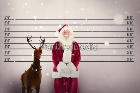 composite image of jolly santa smiling