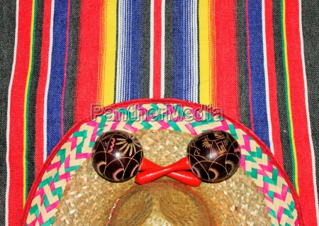 mexico fiesta poncho sombrero maracas background