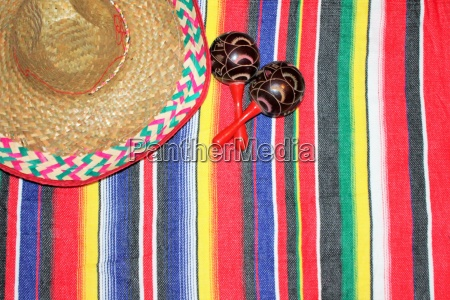 mexico poncho sombrero background with maracas