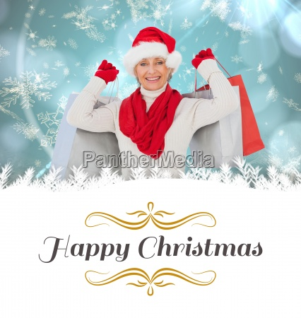 composite image of festive woman holding
