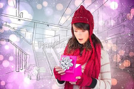 composite image of festive brunette opening