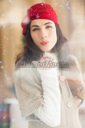 composite image of pretty brunette blowing