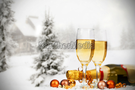 christmas decorations and champagne against winter