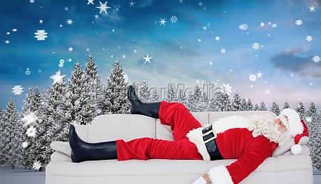 composite image of santa claus sleeping