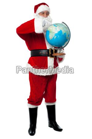 full length portrait of santa holding