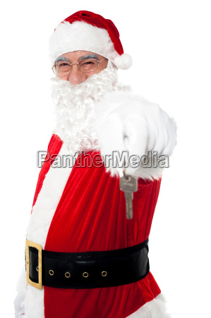 aged man in santa costume offering