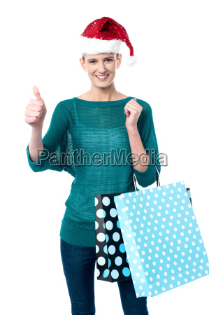 smiling woman shopping for christmas