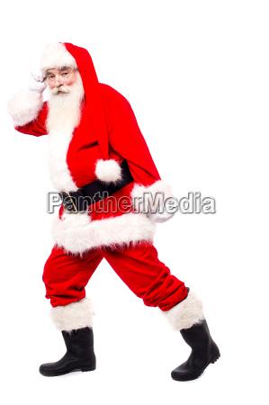 senior man in santa dress dancing