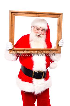 santa posing holding wooden frame